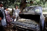 Commander Idi Abdul Tarak in autumn 2001, next to the trunk of the English black Austin A135 Princess Vanden Plas Limousine in the Panshir Valley.