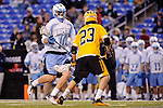 Face-Off Classic: Midfielder Will Fejes #23 of the UMBC Retrievers defends Midfielder Greg Edmonds #10 Hopkins during the UMBC v Johns Hopkins mens lacrosse game at M&T Bank Stadium on March 10, 2012 in Baltimore, Maryland. (Ryan Lasek/ Eclipse Sportswire)