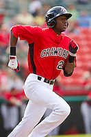 Lewis Brinson (27) of the Hickory Crawdads hustles down the first base line against the Kannapolis Intimidators at L.P. Frans Stadium on May 25, 2013 in Hickory, North Carolina.  The Crawdads defeated the Intimidators 14-3.  (Brian Westerholt/Four Seam Images)