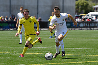 Adam Thurston of Eastern Suburbs competes for the ball with Henry Hamilton of the Wellington Phoenix during the ISPS Handa Men's Premiership - Wellington Phoenix v Eastern Suburbs at Fraser Park, Wellington on Saturday 28 November 2020.<br /> Copyright photo: Masanori Udagawa /  www.photosport.nz