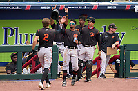 FCL Orioles Orange Coby Mayo (2) celebrates with teammates (L-R) Luis Sena (30), Noelberth Romero (12), Angel Gomez (57), and Ricardo Rivera (17) after hitting a home run during a game against the FCL Braves on July 22, 2021 at the CoolToday Park in North Port, Florida.  (Mike Janes/Four Seam Images)