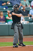 Home plate umpire Joey Amaral signals a strike during a Carolina League game between the Lynchburg Hillcats and the Winston-Salem Dash at  BB&T Ballpark May 22, 2010, in Winston-Salem, North Carolina.  Photo by Brian Westerholt / Four Seam Images
