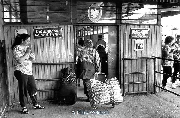 """""""Trade tourists"""" cross into Poland from the Ukraine at the border town of Przemysl with bags of imported goods intended for sale in Poland."""