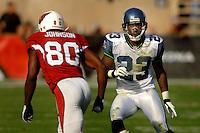 Nov. 6, 2005; Tempe, AZ, USA; Cornerback (23) Marcus Trufant of the Seattle Seahawks covers wide receiver (80) Bryant Johnson of the Arizona Cardinals at Sun Devil Stadium. Mandatory Credit: Mark J. Rebilas