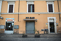 """Gay/LGBTQI+ Street: closed.<br /> <br /> Rome, 12/03/2020. Documenting Rome under the Italian Government lockdown for the Outbreak of the Coronavirus (SARS-CoV-2 - COVID-19) in Italy. On the evening of the 11 March 2020, the Italian Prime Minister, Giuseppe Conte, signed the March 11th Decree Law """"Step 4 Consolidation of 1 single Protection Zone for the entire national territory"""" (1.). The further urgent measures were taken """"in order to counter and contain the spread of the COVID-19 virus"""" on the same day when the WHO (World Health Organization, OMS in Italian) declared the coronavirus COVID-19 as a pandemic (2.).<br /> ISTAT (Italian Institute of Statistics) estimates that in Italy there are 50,724 homeless people. In Rome, around 20,000 people in fragile condition have asked for support. Moreover, there are 40,000 people who live in a state of housing emergency in Rome's municipality.<br /> March 11th Decree Law (1.): «[…] Retail commercial activities are suspended, with the exception of the food and basic necessities activities […] Newsagents, tobacconists, pharmacies and parapharmacies remain open. In any case, the interpersonal safety distance of one meter must be guaranteed. The activities of catering services (including bars, pubs, restaurants, ice cream shops, patisseries) are suspended […] Banking, financial and insurance services as well as the agricultural, livestock and agri-food processing sector, including the supply chains that supply goods and services, are guaranteed, […] The President of the Region can arrange the programming of the service provided by local public transport companies […]».<br /> Updates: on the 12.03.20 (6:00PM) in Italy there 14.955 positive cases; 1,439 patients have recovered; 1,266 died.<br /> <br /> Footnotes & Links:<br /> Info about COVID-19 in Italy: http://bit.do/fzRVu (ITA) - http://bit.do/fzRV5 (ENG)<br /> 1. March 11th Decree Law http://bit.do/fzREX (ITA) - http://bit.do/fzRFz (ENG)<br /> 2. http://bit.do/fzRKm"""