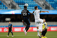 SAN JOSE, CA - SEPTEMBER 16: Jacob Akanyirige #29 of the San Jose Earthquakes goes up for a header with Jaroslaw Niezgoda #11 of the Portland Timbers during a game between Portland Timbers and San Jose Earthquakes at Earthquakes Stadium on September 16, 2020 in San Jose, California.