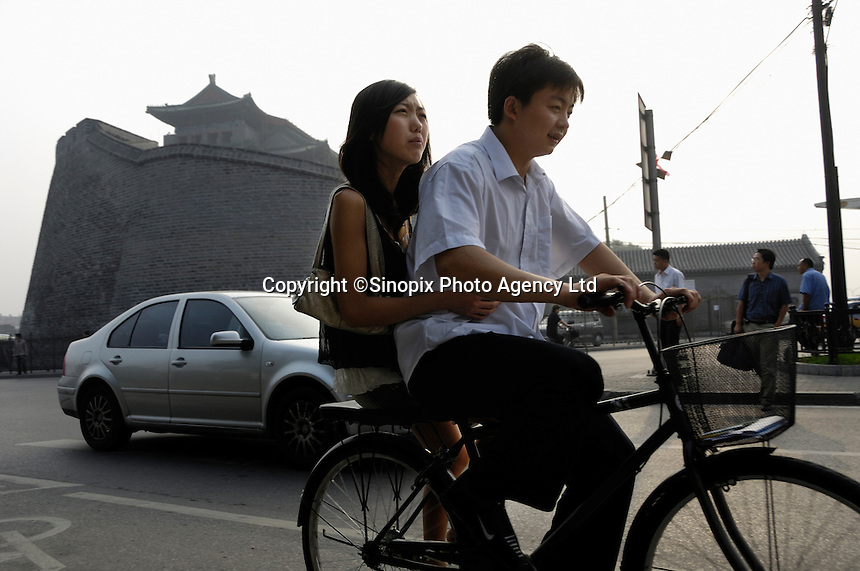 Beijing residents go to work by bicycles in the morning. Beijing municipal government conducts a four day test starting Friday to reduce 1.3 million cars from the streets as a test of the city's ability to address the problems of congestion and pollution caused by emissions for next year's Olympic Games..17 Aug 2007