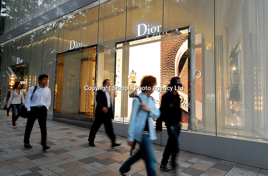 Shoppers walk past Dior in Omotesando in the Harajuku area of Tokyo, Japan. As Japan is seeing the light after over ten years of a stagnant economy public consumer spending is on the increase with new shops and cafes opening and doing well..