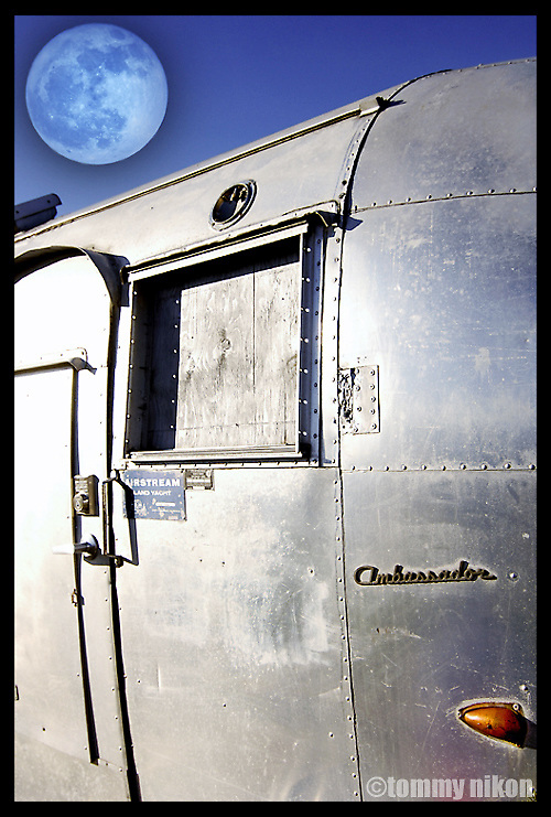 """Airstream trailer/circa 1961...atop parking garage as tool shed for a """"pea patch"""", in-city gardening."""