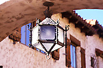 Scotty's Castle<br />Death Valley California<br />Rampant serpents guard the corners of this eight-sided lamp suspended from the arch of the courtyard gate at Scotty's Castle.