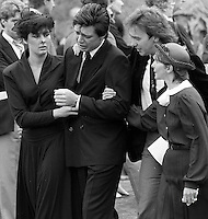 Pix: Copyright Anglia Press Agency/Archived via SWpix.com. The Bamber Killings. August 1985. Murders of Neville and June Bamber, daughter Sheila Caffell and her twin boys. Jeremy Bamber convicted of killings serving life...copyright photograph>>Anglia Press Agency>>07811 267 706>>..A weeping Jeremy Bamber is comforted by his girlfriend Julie Mugford at the funeral of his family, alongside Colin Caffell, father and husband of victims. no date..ref 0006 neg 20.