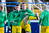 5th April 2021; Palmerston Park, Dumfries, Scotland; Scottish Cup Third Round, Queen of the South versus Hibernian; Paul Hanlon of Hibernian warms up before kick off in the early evening sun