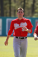 Ohio State Buckeyes 3rd baseman Josh Dezse #33 running in the outfield before a game against the Coastal Carolina Chanticleers at Watson Stadium at Vrooman Field on March 11, 2012 in Conway, SC.  Coastal Carolina defeated Ohio State 3-2. (Robert Gurganus/Four Seam Images)