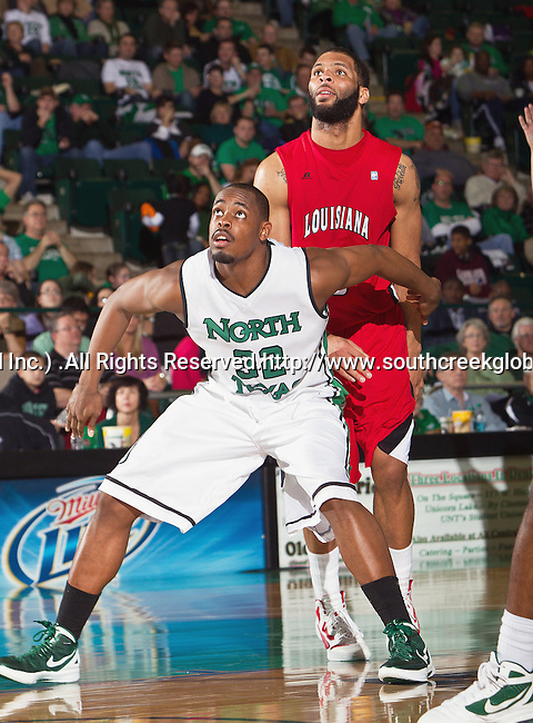 North Texas Mean Green forward Roger Franklin (32) and Louisiana Lafayette Ragin Cajuns forward J.J. Thomas (5) in action during the game between the Louisiana Lafayette Ragin Cajuns and the University of North Texas Mean Green at the North Texas Coliseum,the Super Pit, in Denton, Texas. Louisiana Lafayette defeats UNT 57 to 53.