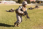 October 22, 2014. Camp LeJeune, North Carolina.<br />  LCpl. Jada Connor advances past other members of her fire team with a M27 Infantry Automatic Rifle during patrol training for the 3rd Platoon of the Ground Combat Element Integrated Task Force. Marines in 3rd Platoon of the GCEITF are all considered provisional infantrymen as they have not been to the School of Infantry (SOI) previous to volunteering for the GCEITF.<br />  The Ground Combat Element Integrated Task Force is a battalion level unit created in an effort to assess Marines in a series of physical and medical tests to establish baseline standards as the Corps analyze the best way to possibly integrate female Marines into combat arms occupational specialities, such as infantry personnel, for which they were previously not eligible. The unit will be comprised of approx. 650 Marines in total, with about 400 of those being volunteers, both male and female. <br />  Jeremy M. Lange for the Wall Street Journal<br /> COED