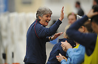 US Head Coach Pia Sundhage celebrates with the US bench after Abby Wambach scored her first goal in a game vs Norway during the 2010 Algarve Cup. Game was played in Olhao, Portugal.