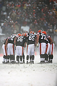 December 16th, 2007:  The Cleveland Browns huddle up before a play vs. the Buffalo Bills.  The Browns offensive line; Ryan Tucker (72), Hank Fraley (66), Eric Steinbach (65), Joe Thompson (73) were main factors in the Browns 8-0 shutout of the Bills at Cleveland Browns Stadium in Cleveland, Ohio to inch closer to clinching a playoff spot.  Photo copyright Mike Janes Photography 2007.