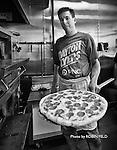 Large pepperoni: Flying pizza, downtown Dayton Ohio