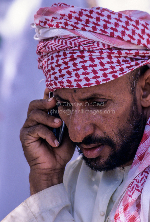 Mudhaireb (Mudayrib), Oman.  Middle-aged Omani Man Talking on his Cell Phone.