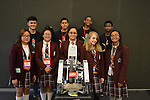 Nights and Roses with their robot. YWCPA students front row, left to right: Guadalupe Ramirez, Diana Hernandez, Janet Santacruz, Starr Morris, and Courtney Dubuclet. MLCPA students back row left to right: Luis Torres, Evert Guzman, Marcellus Jordan, and Jarmel Brown.