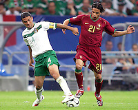 Rafael Marquez (4) of Mexico and Nuno Gomes (21) of Portugal have a foot on the ball. Portugal defeated Mexico 2-1 in their FIFA World Cup Group D match at FIFA World Cup Stadium, Gelsenkirchen, Germany, June 21, 2006.