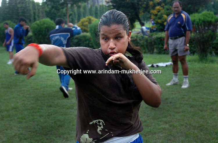 INDIA (West Bengal - Calcutta)July 2007,Shakila Babe  at practice at Sports Authority of India Complex (East Zone) in Kolkata. Shakila and Shanno are twins from a poor muslim family of Iqbalpur, Kolkata. . Inspite of their late father's unwillingness to send his daughters to take up  boxing her mother Banno Begum inspired them to take up boxing at the age of 3. Their father was more concerned about the social stigma they have in their community regarding women coming into sports or doing anything which may show disrespect to the religious emotions of his community. Shakila now has been recognised as one of the best young woman boxers of the country after she won the  international championship at Turkey in the junior category. Shanno is also been called for the National camp this year. Presently Shakila and shanno has become the role model in the Iqbalpur area  and parents from muslim community of Iqbalpur have started showing interst in boxing. Iqbalpur is a poor muslim dominated area mostly covered with shanty town with all odds which comes along with poverty and lack of education. - Arindam Mukherjee