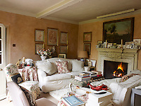 A fire blazes in the marble fireplace adding to the feeling of cosy charm