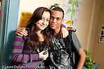 Education High School couple hugging in corridor