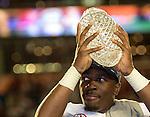 Defensive MVP, Alabama's C.J. Mosley hoist the BCS National Championship crystal football after defeating Notre Dame 42-14 at Sun Life Stadium in Miami on January 7, 2013.  <br /> Credit: Mark Wallheiser for UPI Newsphotos ©2013 Mark Wallheiser