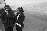 """- December 23, 1990 the criminal gang said """" white UNO"""" (from the name of a Fiat car model), already responsible for several murders and robberies, attack a nomad camp on the outskirts of Bologna, killing two people; funeral of victims....- il 23 dicembre 1990 la banda criminale detta """"della UNO bianca"""", già responsabile di numerosi omicidi e rapine, assale un campo nomadi alla periferia di Bologna, uccidendo due persone; funerale delle vittime"""