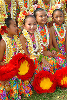 The children or 'keiki' from Halau Hula O Hokulani at the Lei Day Festivities at the Kapiolani Park Bandstand at Waikiki, Honolulu, Hawaii