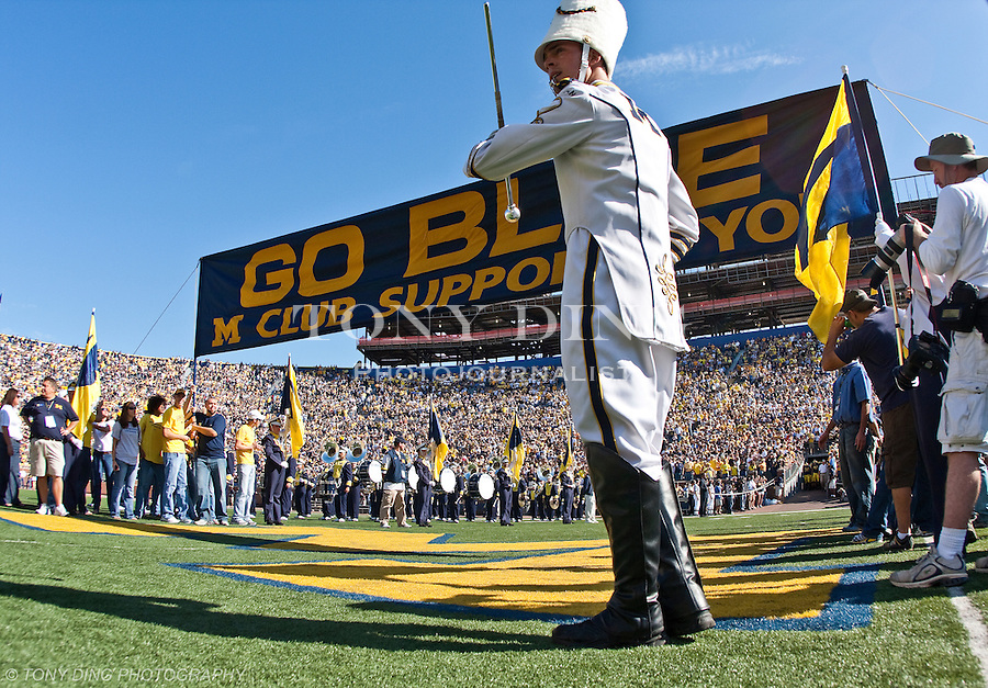 """11 October 2008: The Michigan Marching Band drum major prepares to signal for the Michigan football team to take the field under the """"Go Blue"""" banner, before an NCAA college football game between the Michigan Wolverines and Toledo, at Michigan Stadium in Ann Arbor, Michigan."""