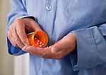 USA, Illinois, Metamora, Senior man pouring pills into hand, mid section