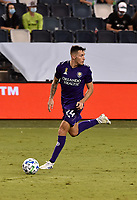 KANSAS CITY, KS - SEPTEMBER 23: #24 Kyle Smith of Orlando City SC controls the ball in the backfield during a game between Orlando City SC and Sporting Kansas City at Children's Mercy Park on September 23, 2020 in Kansas City, Kansas.