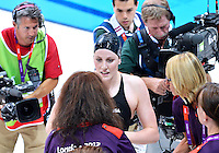 July 30, 2012..MISSY FRANKLIN of the USA speaks to an officials on her way out of the pool after winning Gold Medal in women's 100m backstroke eventl at the Aquatics Center on day three of 2012 Olympic Games in London, United Kingdom...