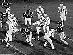 Bethel Park PA:  Defensive play with Mike Stewart and Glenn Eisaman stopping the Highlander quarterback.  Others in the photo; Ray Tedesco 61, Gary Biro 81, Dennis Franks 66, Jimmy Beck 67, and Dan Hannigan 64. After Scott Streiner was injuried on the first play, the team rallied and came up just short of winning the game when they missed a two-point conversion late in the 4th quarter (7-6).  Defensive unit was one of the best in Bethel Park history only allowing a little over 7 points a game.