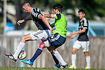 Dario Damjanovic of Sun Pegasus FC (L) competes for the ball with Chi Hing Lui of Wofoo Tai Po (R) during the HKFA Premier League between Wofoo Tai Po vs Sun Pegasus at the Tai Po Sports Ground on 22 November 2014 in Hong Kong, China. Photo by Aitor Alcalde / Power Sport Images