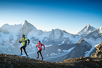 Trail running on the Pigne de la Lé, 3396 meters, at sunrise, while on the Via Valais, a multi-day trail running tour connecting Verbier with Zermatt, Switzerland. In the distance is the Matterhorn.