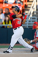 Miguel Velazquez #15 of the Hickory Crawdads follows through on his swing against the Greenville Drive at  L.P. Frans Stadium May 8, 2010, in Hickory, North Carolina.  Photo by Brian Westerholt / Four Seam Images