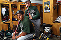 Oceanside baseball players Austin Sandoval, seated, and Saul Sandoval both use the same model bat. photo by Bill Wechter