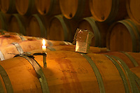 The winery, barrel aging cellar: a burning candle, a box of sulphur pellets - Chateau Baron Pichon Longueville, Pauillac, Medoc, Bordeaux, Grand Cru