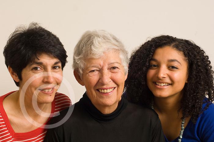 Three generations of same family: grandmother, mother, and teenage grandaughter portrait closeup horizontal biracial Caucasian and African American