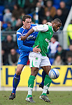 St Johnstone v Hibs....05.03.11 .Akpo Sodje holds off Graham Gartland.Picture by Graeme Hart..Copyright Perthshire Picture Agency.Tel: 01738 623350  Mobile: 07990 594431