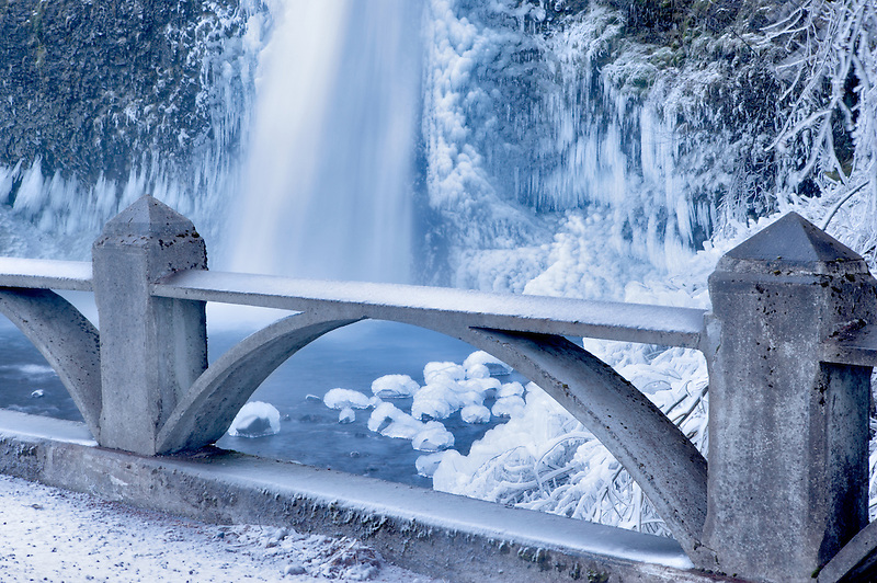 Lower Horsetail Falls with bridge and ice. Columbia River Gorge National Scenic Area. Oregon
