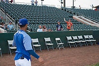 A fan plays catch with Jeremy Arocho (8) before a Pioneer League game between the Ogden Raptors and the Great Falls Voyagers at Lindquist Field on August 23, 2018 in Ogden, Utah. The Ogden Raptors defeated the Great Falls Voyagers by a score of 8-7. (Zachary Lucy/Four Seam Images)