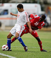 Kianz Froese (7) of Cuba keeps possession away from Alexander Gonzalez (20) of Panama during the group stage of the CONCACAF Men's Under 17 Championship at Jarrett Park in Montego Bay, Jamaica. Panama tied Cuba, 0-0.