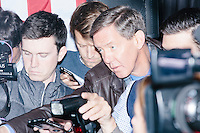 """Long-time Fox News political reporter Carl Cameron, known as """"Campaign Carl,"""" holds a mic out as Texas senator and Republican presidential candidate Ted Cruz speaks to the media before a speech at The Village Trestle restaurant in Goffstown, New Hampshire, on Wed., Feb. 3, 2016."""