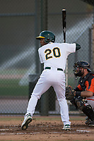 AZL Athletics right fielder Danny Bautista (20) at bat during an Arizona League game against the AZL Giants Orange at Lew Wolff Training Complex on June 25, 2018 in Mesa, Arizona. AZL Giants Orange defeated the AZL Athletics 7-5. (Zachary Lucy/Four Seam Images)
