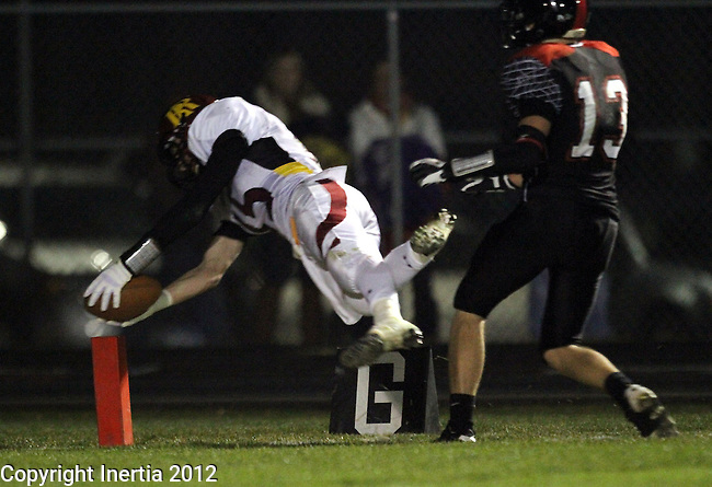 BRANDON, SD - NOVEMBER 3: Lucas Wilber #15 from Roosevelt dives to the pylon but is out of bounds at the one past Adam Bauer #13 from Brandon Valley in the second quarter of their Class 11AA Semifinal game Saturday night at Brandon Valley High School. (Photo by Dave Eggen/Inertia)