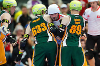 15 MAR 2014 - BIRMINGHAM, GBR - Team England jammer Ballistic Whistle (third from centre) tries to force his way between Wizard of Aus blockers Milling and Kernel Panic during the two countries bout at the inaugural Men's Roller Derby World Cup in the Futsal Arena in Birmingham, West Midlands, Great Britain (PHOTO COPYRIGHT © 2014 NIGEL FARROW, ALL RIGHTS RESERVED)